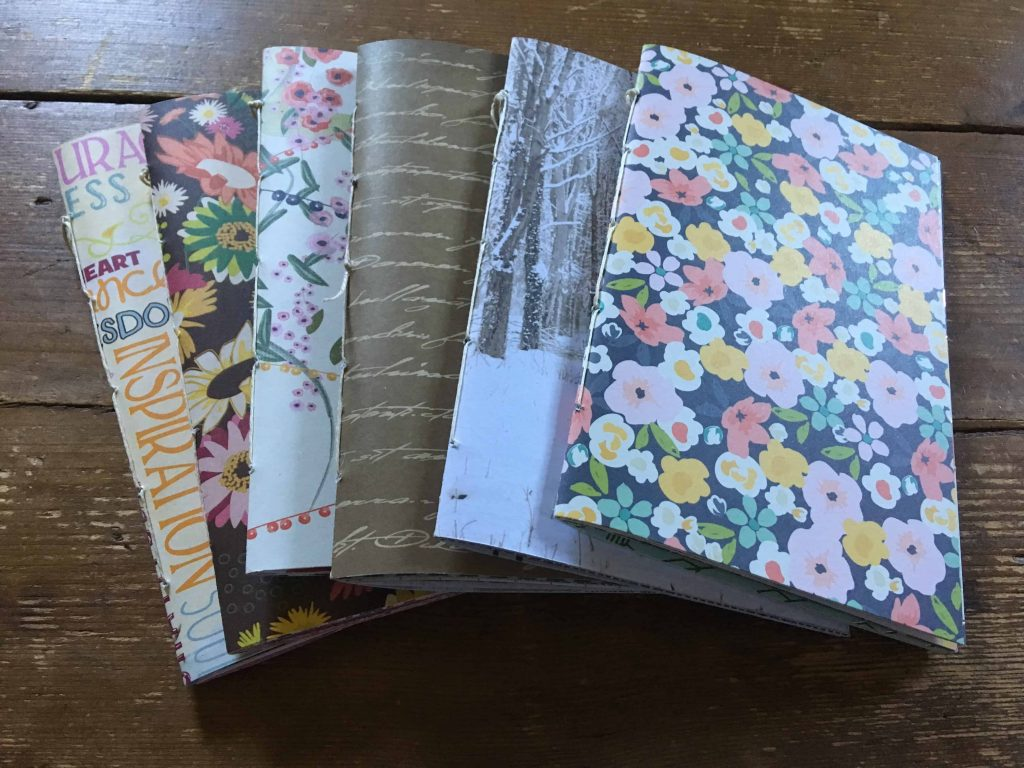 junk journals made with various scrapbook papers